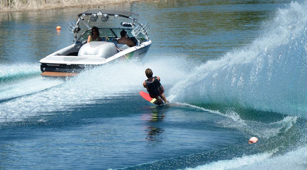 water skier towed behind boat