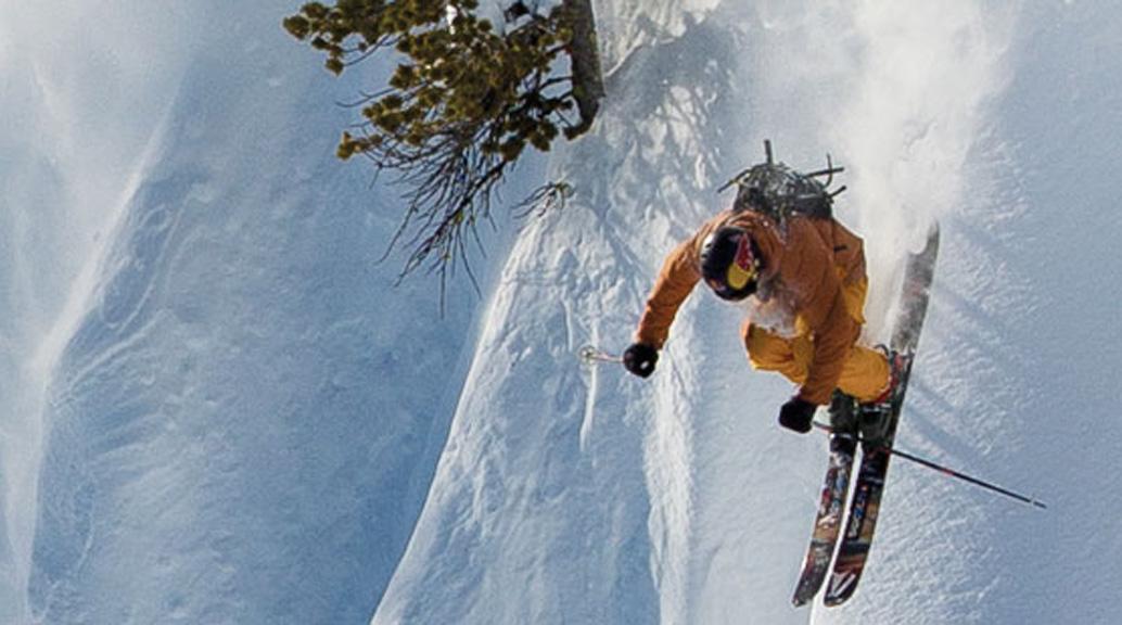 skier down steep slope