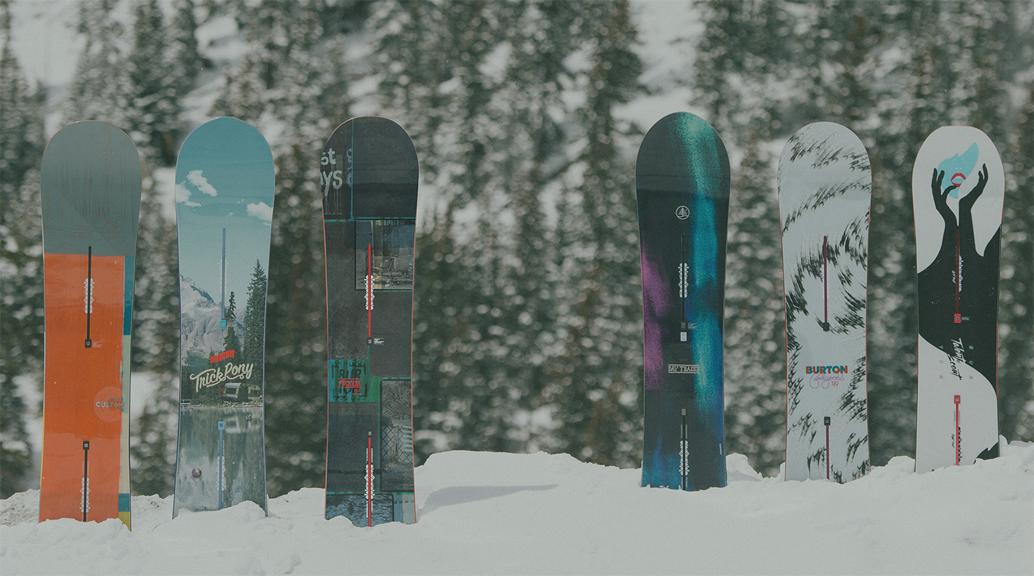 burton snowboards stood up in snow