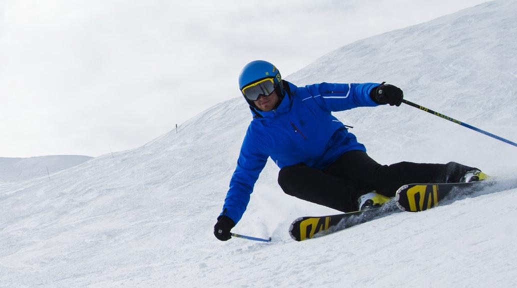 salomon skier wearing glove skiing piste