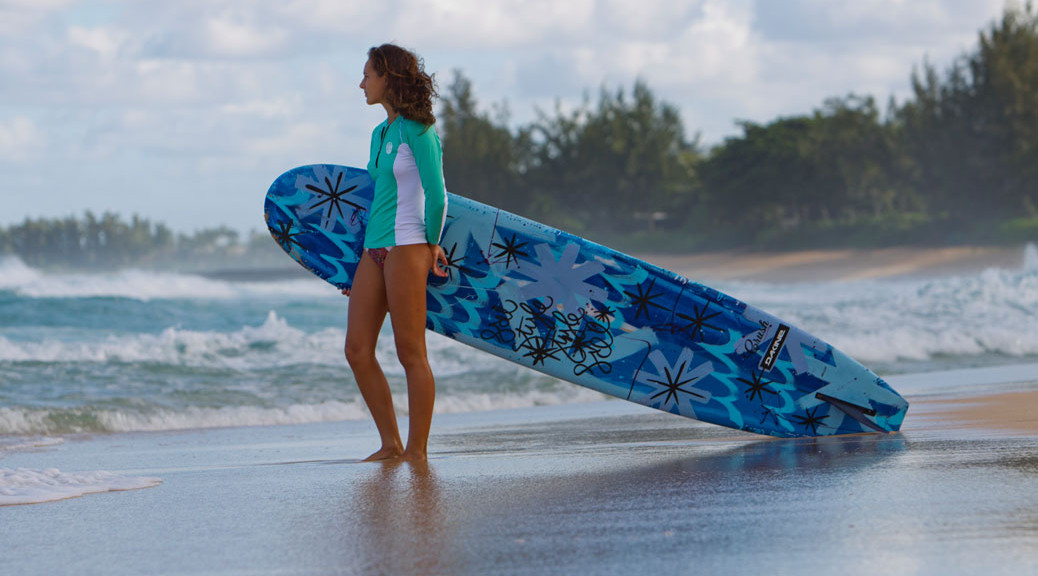 female surfer wearing oneill rash guard