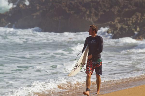 male surfer wearing oneill rash guard