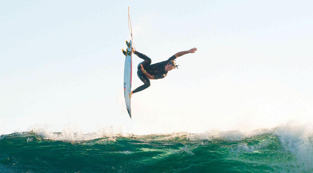surfer above wave