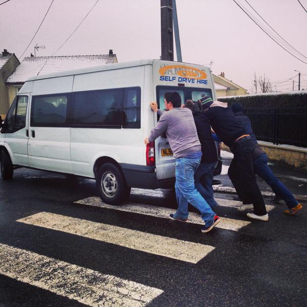 guys pushing broken down van