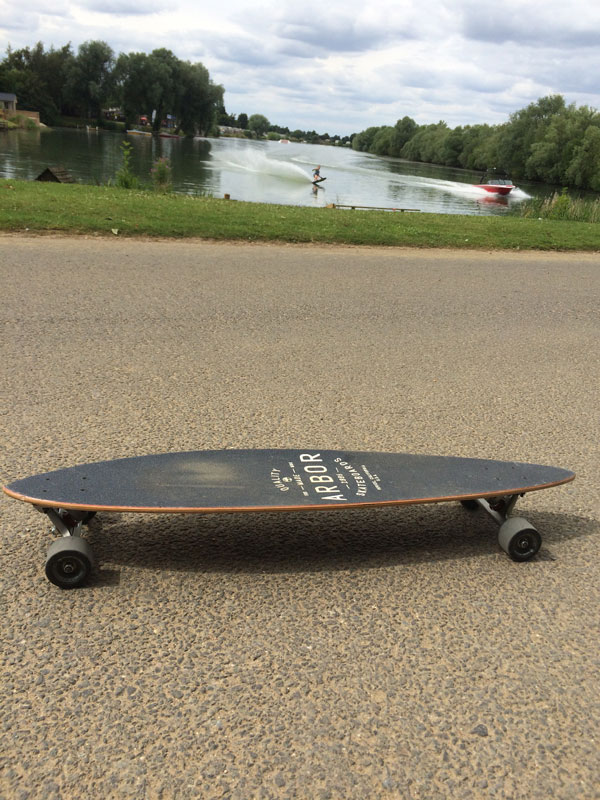 arbor skateboard with lake in background