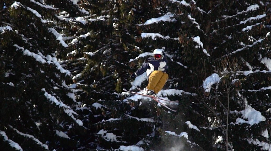 skier in the air trees