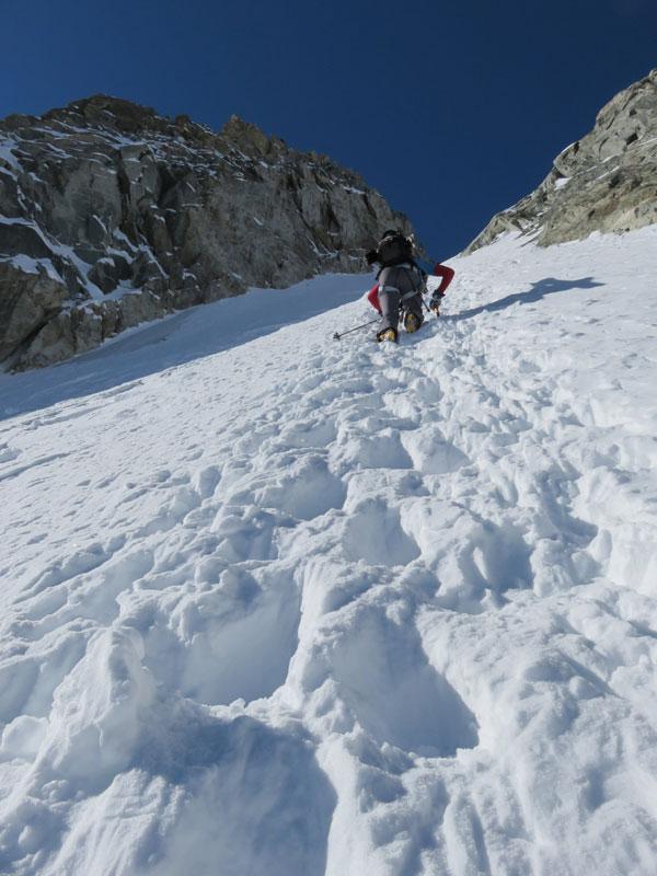 skier climbing col