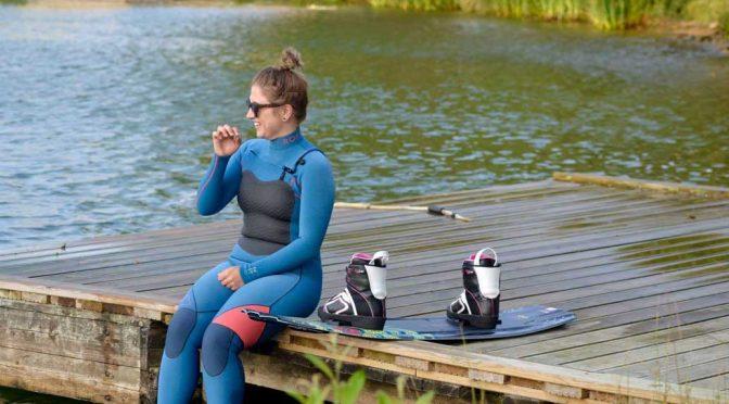 girl wakeboarder wearing roxy wetsuit