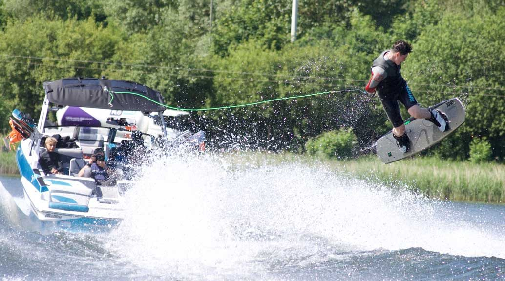 wakeboard boat towing wakeboarder