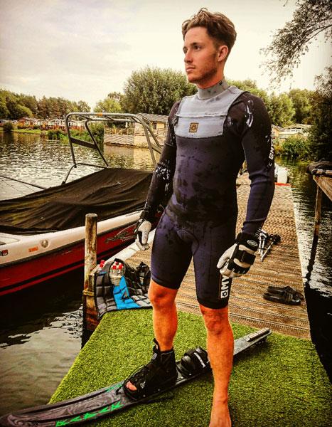water skier wearing mystic wetsuit