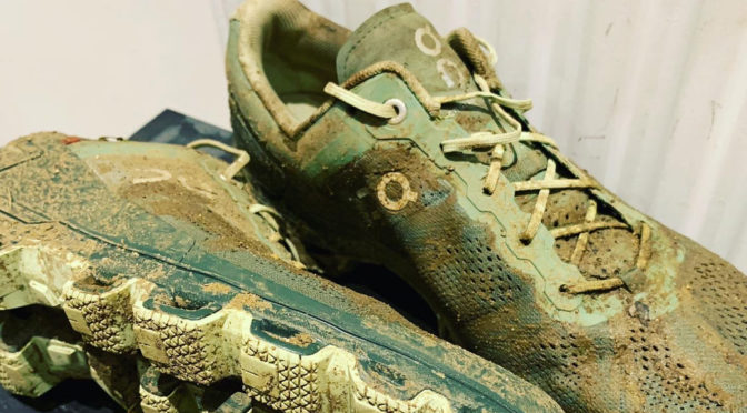 muddy trail running shoes on cloudventure
