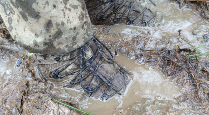 walking boots in muddy water