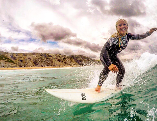 female surfer catching a wave off Cornwall.